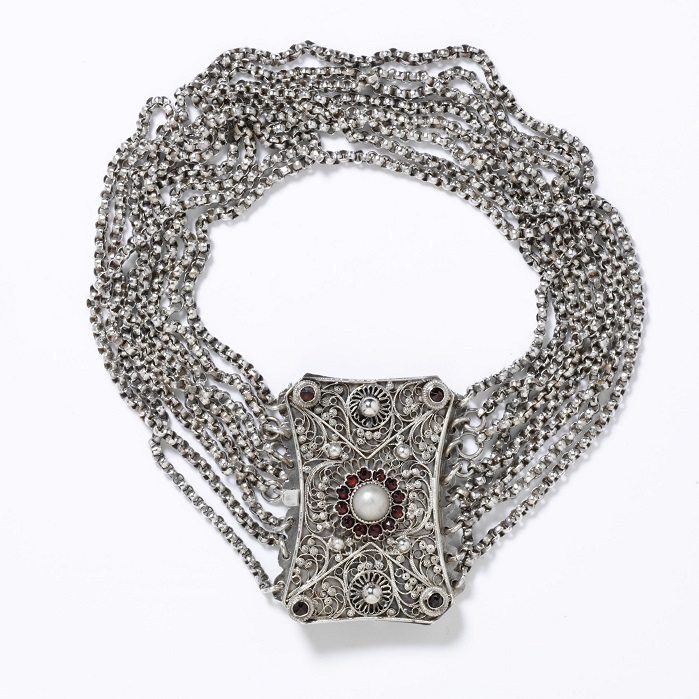 This is a Kropfkette (goiter chain) that Austians and Germans wore circa 1840-1870 to hide lumps on their necks from iodine deficiencies.  (c) Victoria and Albert Museum, London